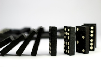 Falling dominoes caught in motion