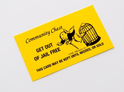 Monopoly pieces and Get Out of Jail Free card