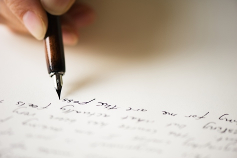 Close up of pen writing a letter