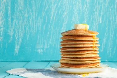 Stack of pancake with honey and butter on top